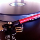 F-dot-cross tonearm by the Funk Firm headshell assembly is slotted to give the proper angle on the cartridge mount.