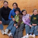 This is my family visiting Crystal Geyser in Southern Utah last April.  We're sitting on a shelf of minerals that has covered the landscape thanks to years of the geyser spewing it's watery goodness into the air.