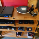 Heed's CD transport and DAC with The Funk Firm's Vector 3 turntable, fitted with their FX.R tonearm and Transfiguration Axia cartridge. Middle shelf: Heed's Obelisk Preamp and external power supply and to the right of that (under the turntable) is their new DACtilus USB/Coax DAC (we used this with a laptop for music) and the Heed Quasar phono stage with dedicated external power supply.  On the 3rd shelf down: another Heed Obelisk Si integrated amp with external power supply option.